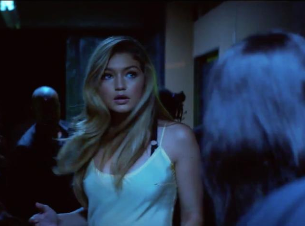 Gigi Hadid walking down corridor