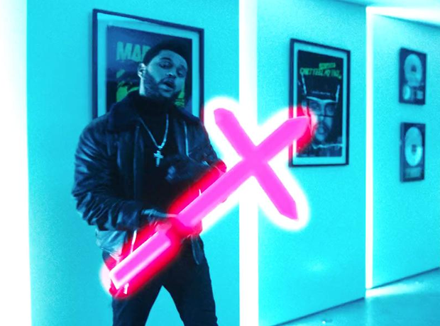 The Weeknd holding a cross in his Starboy Video
