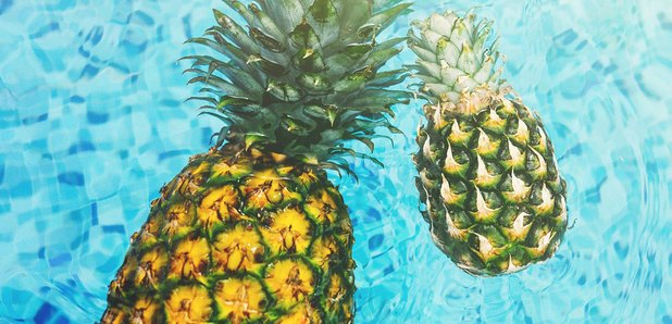 Pineapples in swimming pool
