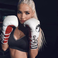 Image 8: Pia Mia wearing boxing gloves.